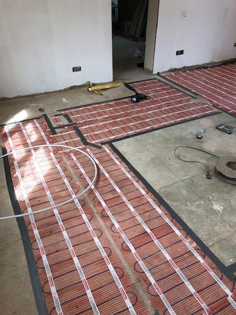 Image of some underfloor heating being installed 1