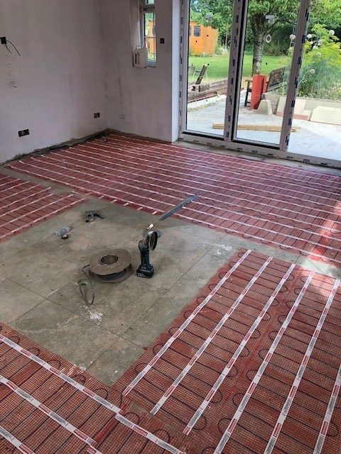 Image of some underfloor heating being installed 2